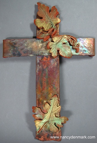 copper cross with polymer clay grape leaves by Nancy Denmark Ken Webb