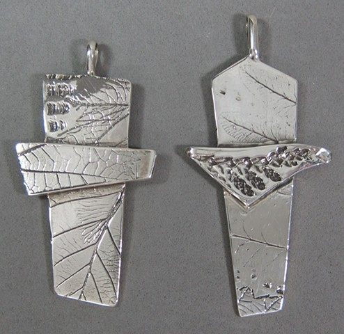silver crosses made by Nancy Denmark with impressions from nature