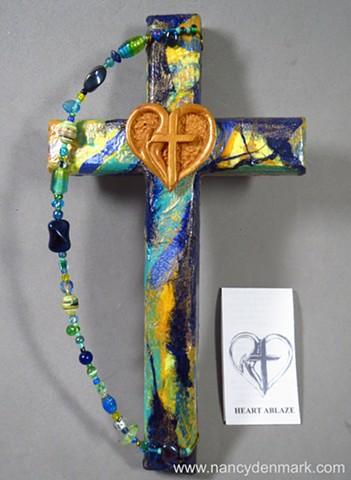 collage wall cross with polymer clay symbol by Nancy Denmark