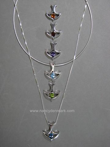 descending dove design with gemstone by Nancy Denmark