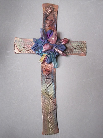 copper wall cross embellished with crystals, clay, and wire