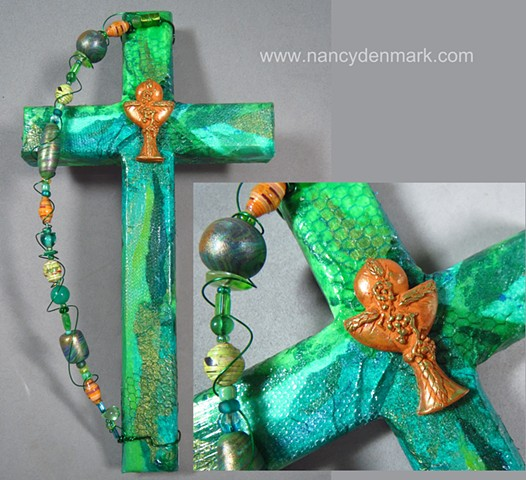 collage and symbol wall cross made by Nancy Denmark
