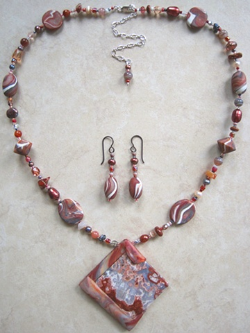 beaded polymer clay necklace set featuring crazy lace rosetta stone