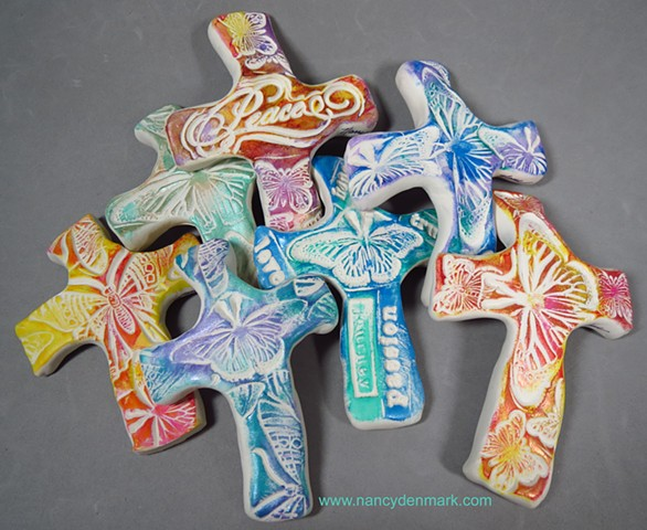 hand crosses impressed with butterfly designs by Nancy Denmark