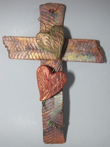textured copper wall cross with 2 polymer clay hearts by Nancy Denmark