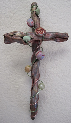 copper wall cross embellished with polymer clay beads and wire