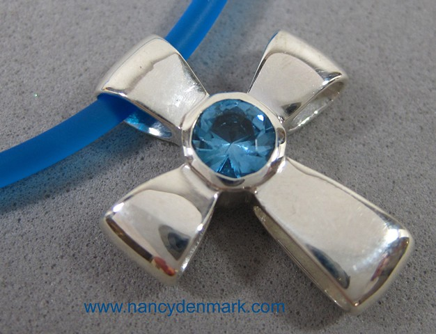 sterling silver ribbon cross with faceted blue topaz © Nancy Denmark