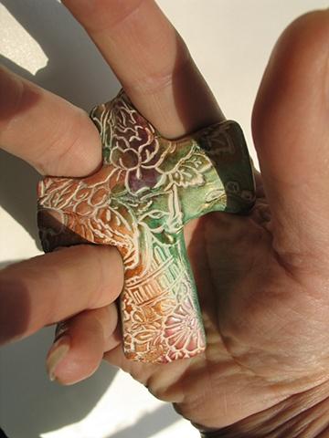 A CROSS IN HAND