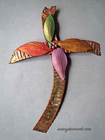 copper wall cross by Ken Webb embellished with polymer clay leaves by Nancy Denmark