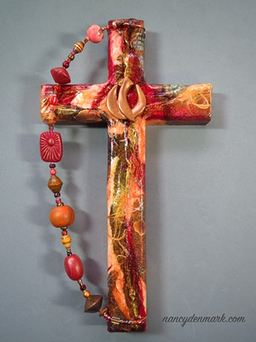 wall cross with descending dove symbolism by Nancy Denmark