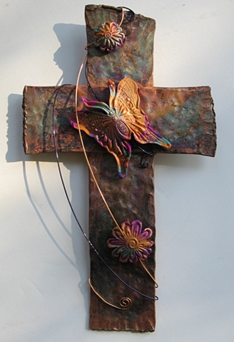 copper wall cross with polymer clay butterfly & flower embellishment