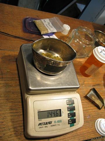 GOLD BEING WEIGHED FOR CASTING