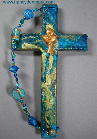 chalice and host symbol on collage wall cross by Nancy Denmark and Patti Reed