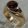 14K UP SWIRL RING W/ GARNET