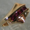 14K RING WITH CHANNEL OF RUBIES VIEW 2