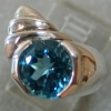 R 37 STERLING W/ BLUE TOPAZ RING