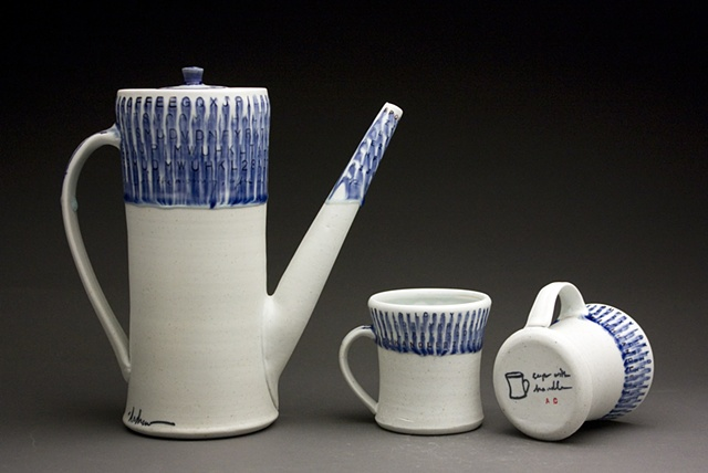 Coffeepot and two cups