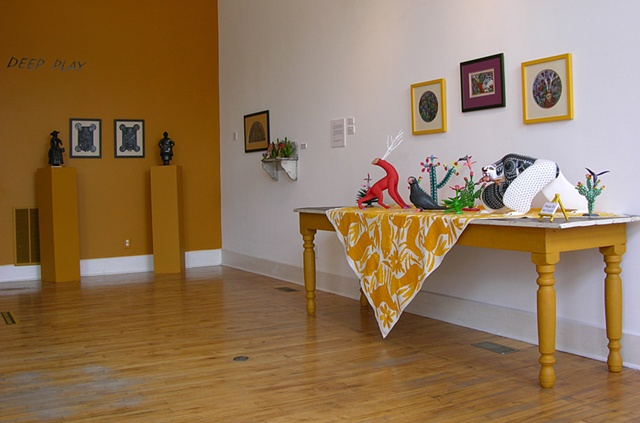 View of carved Alebrijes from Mexico and my gouache paintings above