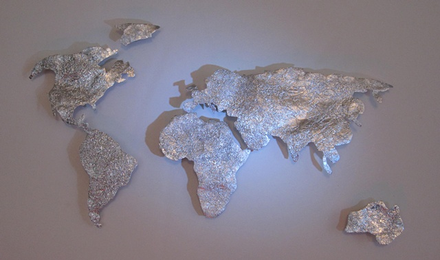 Map of the world made from foil found in the street