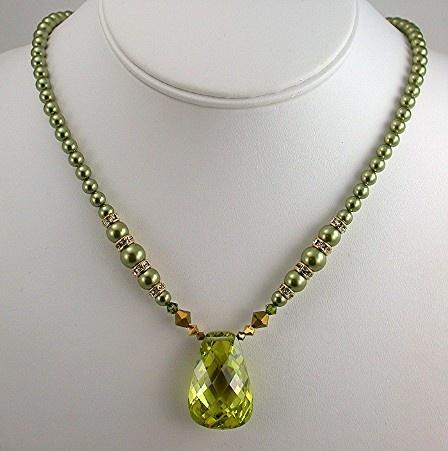 Peridot Cubic Zirconia and Swarovski Pearls.