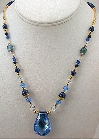 London Blue Topaz CZ with Sapphires, Kyanite, and Swarovski crystal.