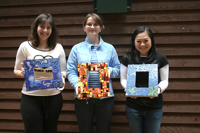 Students with finished mosaic frames