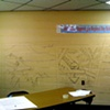 "Drawings of the ""postcard"" murals in teachers lounge, before they were painted by volunteers"