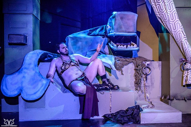 A Whale Puppet with Matt Grant in a Slave Leia costume