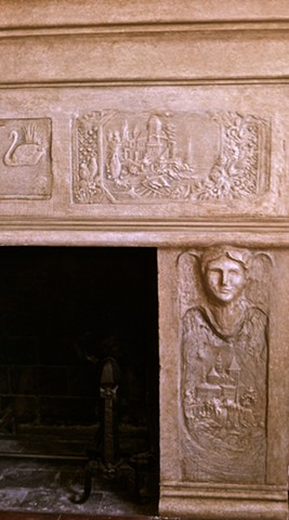 Hand sculpted features on plaster fireplace