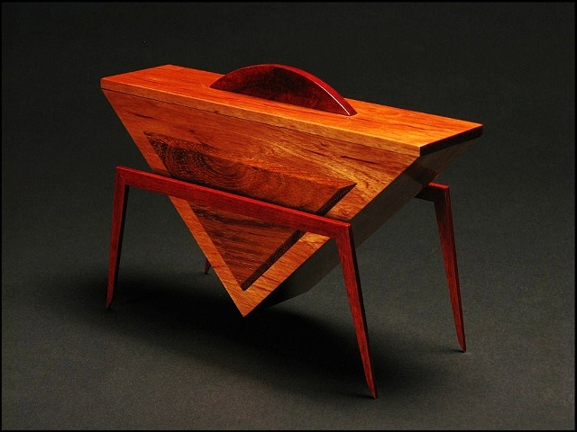 Peace Vessel is a unique sculptural wooden vessel of Mahogany, Jatoba, Cardinal Wood and metal.