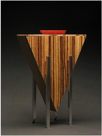 Closed Vessel is a unique sculptural wooden vessel of Zebra Wood, Ebony, Cardinal Wood and metal.