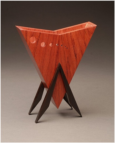 Jatoba Vessel is a unique sculptural wooden vessel of Jatoba and Walnut.