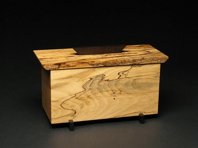 Eastern Gift is a unique sculptural wooden vessel of spalted Magnolia, ebonized Walnut and metal.