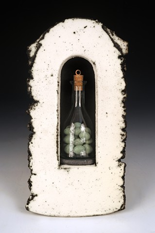 Reliquary with glass bottle full of wooden eggs