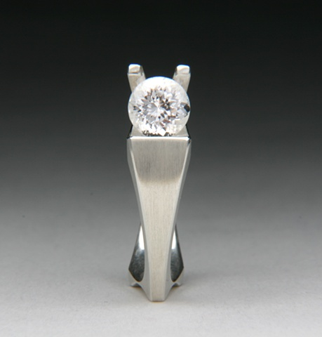 Snail ring is a contemporary design set with a white Danburite
