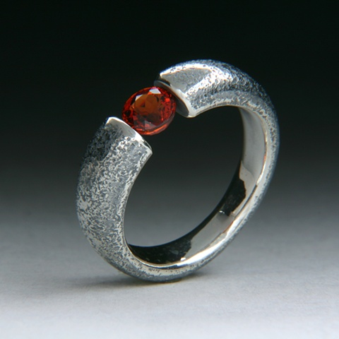 Sterling silver tension set garnet ring