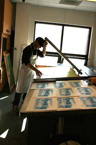 Devan Burry printing his four-colour silkscreen
