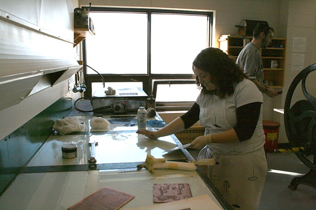 Rachel Anstey wiping her photogravure plate