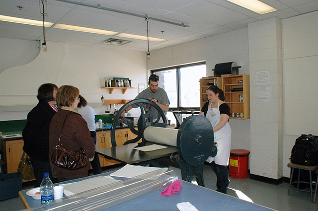 Marc Bernier and Danielle Reardon printing a photogravure