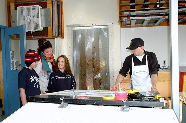 Devan Burry welcomes visitors to the screen printing studio