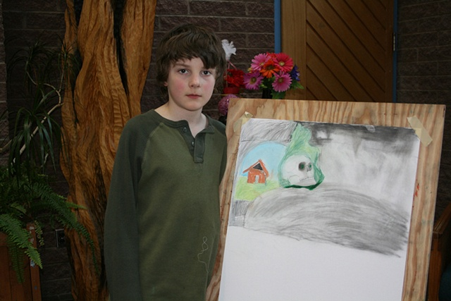 Young draftsman with his work