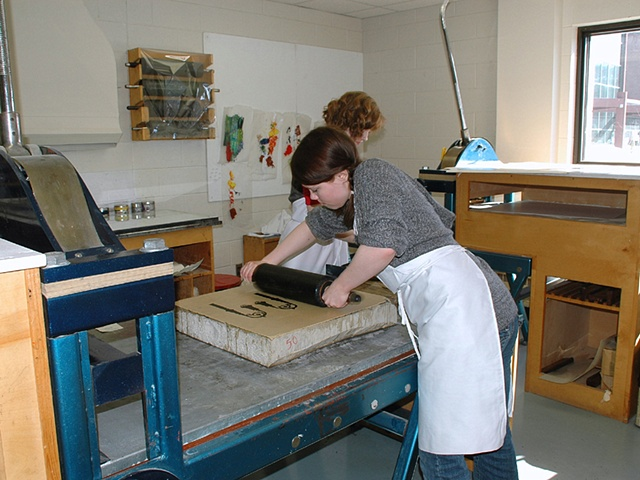 Gabby Hughes rolls up a litho stone