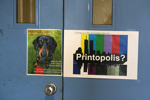 Printopolis posters on shop door
