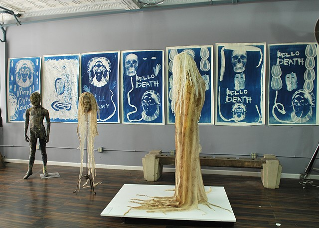 Studio shot of snake shed sculptures and cyanotypes in progress