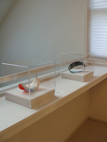 Photograph of two map collage sculptures for Fathom exhibition at the CMCA by Shannon Rankin
