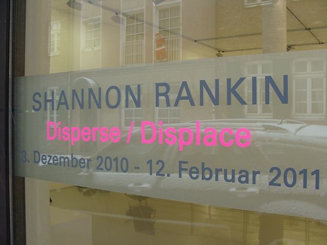 Photograph of signage for Disperse Displace exhibition at Gallery Voss by Shannon Rankin