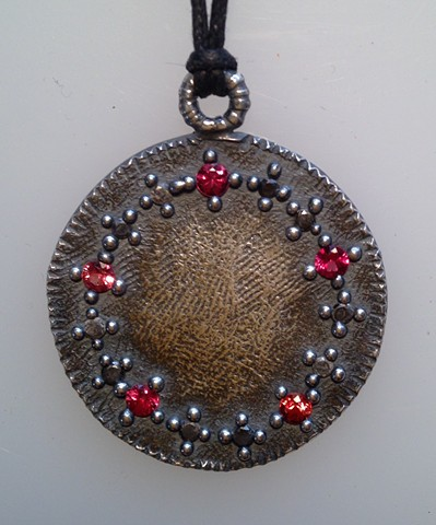 Medallion with Orange Sapphires and Black Diamonds