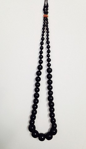 Knotted Black Graduated Bead Necklace with Bronze and Red Stone Clasp