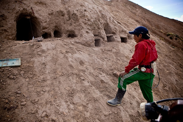 "Marvin (14) looks at the ""playground mines"". These are small tunnels made for 5+ year old kids for them to play and get used to darkness, lack of air and crawling inside the mine. Children are specially useful to reach in small cavities that grownups woul"