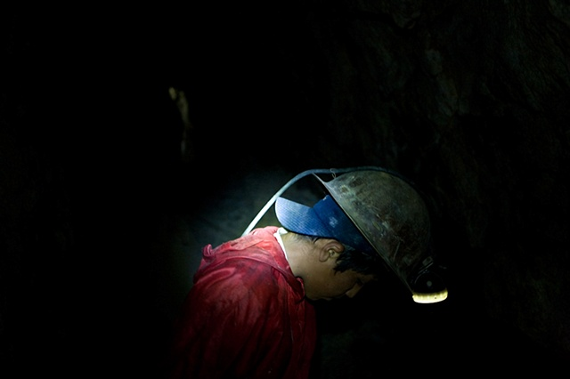 "Marvin (14) works in the mine since he's 11. He earns 42 dollars a week working in his father's ""paraje"" (section of one of the mines). He is already a year behind in school and desperate to back to school and get out of the mine."